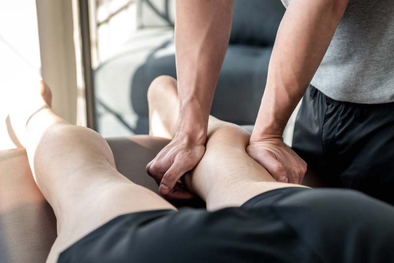 chiropractor performing soft tissue therapy
