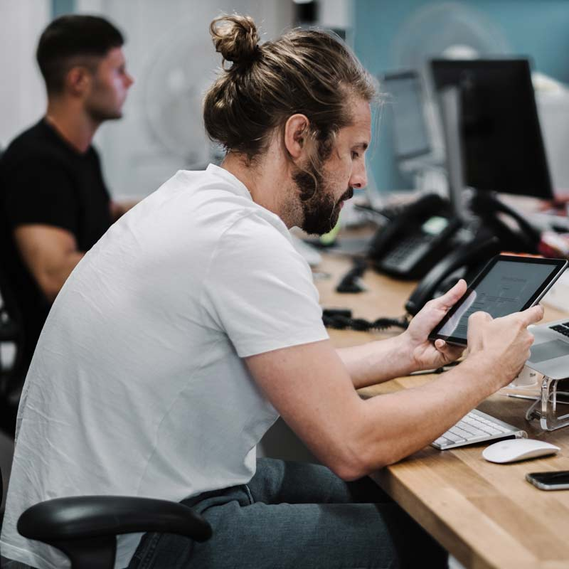 man working in an office with upper crossed syndrome