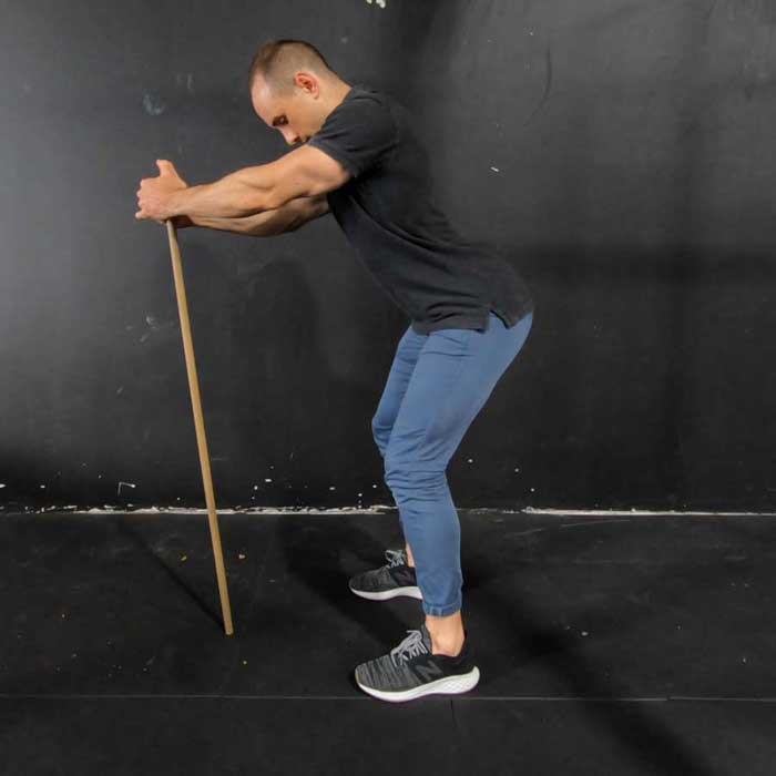standing supported pelvic tilt exercise