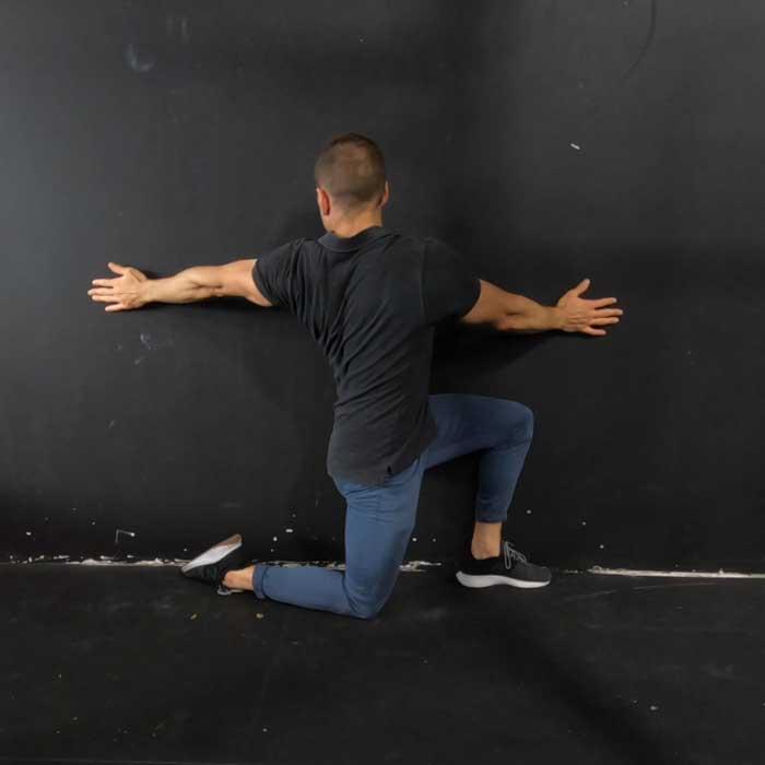 half kneeling wall thoracic rotation exercise